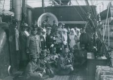 Sailors and crew members gathered on the ship.