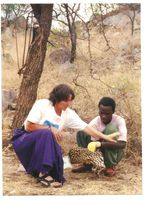 Animal Lion:Melody roelke parker and african assistant.