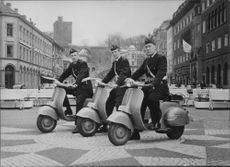 Police officers patrol manages to mopeds.