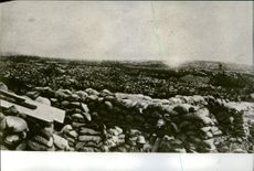 Vintage photo of a camp protected by piled sacks of soil during the world war in 1968.