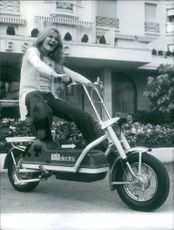 A woman riding on the motorcycle.