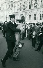 A man was captured by the police with people around on the street, 1971.