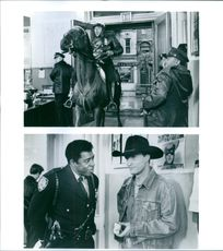 "Ernie Hudson and Woody Harrelson starring in the film ""The Cowboy Way""."