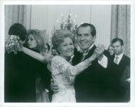US Former President Richard Nixon, together with his wife, Pat Nixon, is dancing at a festive event.