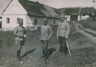 Soldiers gathered while standing in the village during the WWI.