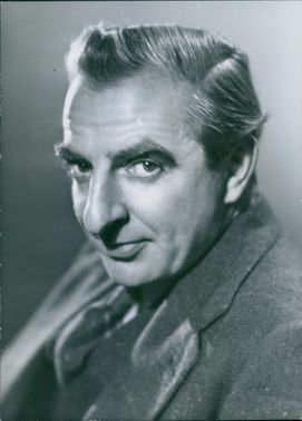 Vintage photo of Hugh Griffith, looking at the camera.