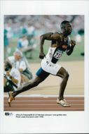 Michael Johnson runs in his golden shoes during the Olympic Games in Atlanta in 1996