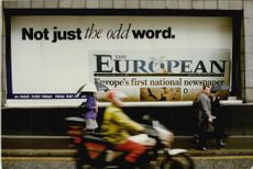 The European newspaper covers the walls.