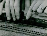 Model of car and railway track. 1966