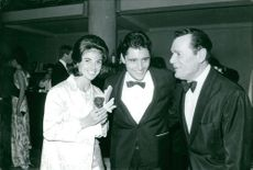 Sacha Distel with wife Francine and another man.  Taken - Circa 1967
