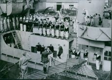 American and French officers and seamen stand at attention on the destroyer escort Senegalese presented to France by the U.S.