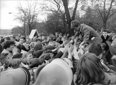 Fans lifting Robert F. Kennedy in joy.