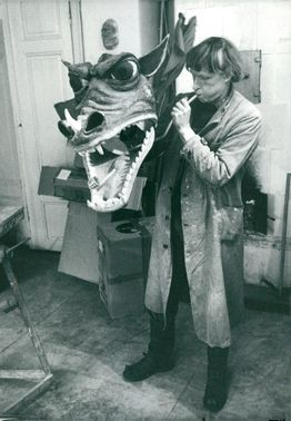 Portrait Arne Högsander, dock creator and artist, along with the dragon from the TV-Troll flute.