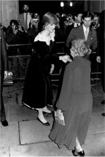 Princess Diana and Prince Charles greet the audience when they arrive at the National Film Theater.