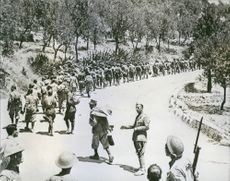 Italian prisoners who surrendered to the Allies during perations in Sicily are marched away from Noto. After less than a month of the Sicilian campaign the Allies held 125,000 prisoners.
