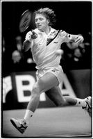 Boris Becker takes the long leg to save a ball.