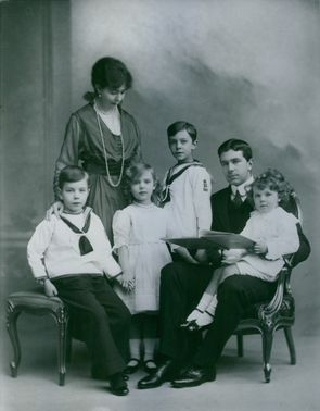 Prince Gustaf with his royal family. with Princess Margaretha, his daughter siiting on his lap.