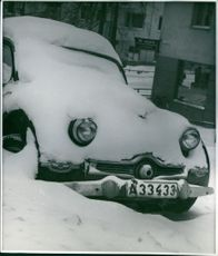 Snow covered car - winter photography by Ellen Dahlberg