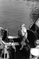 Princess Anne's children on yacht, wearing a life jacket.