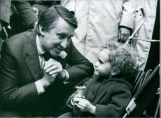British politician, David Steel, meets three-year-old Kate Potter during a pre-Election visit to Islington, London, 1983.