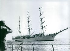 Man looking The three masted Polish square rigged sailing ship 'Dar Mlodziezy'.