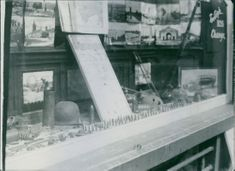 View of a shop window where German bullets and steel helmets being sold.
