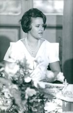 Princess Muna, wife of King Hussein of Jordan, at a party.