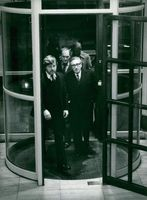Henry Kissinger with security guards