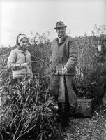 Prince Juan of Spain with a woman in a forest hunting.