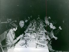 Portrait of a Greek military Stylianos Pattakos having dinner with men and women. 1967