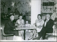 William Boeing having drinks with friends.