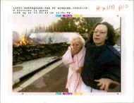 The 1994 Northridge earthquake USA:is comforted by an  unindentified woman.