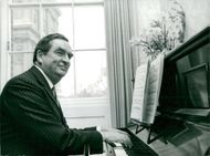 Denis Healey at the piano