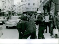 Police arrested a man in downtown, 1964.