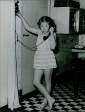 A photo of reigned as Queen of the Netherlands from 1980 until her abdication in 2013 Beautiful Beatrix talking on telephone and smiling during her childhood. 1966
