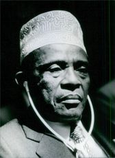 President Ahmed Abdallah photographed wearing a headphone. 1981.