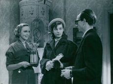 A scene of a Swedish actress Inga Sofia Tidblad, a Swedish actor , scriptwriter and music lyricist Elsa Prawitz and  a Swedish actor, theatre director, songwriter and singer Stig Olin from the film Divorced. 1951