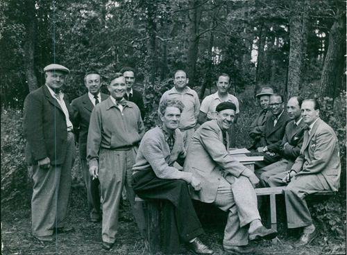 A group of people in forest, facing camera and smiling. 1954  The population of Ractuna neighborhood occupies