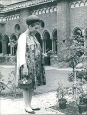 Sylvia Casablanca, expecting her first child, looking at plant saplings.