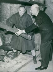 Richard Widmark as The Dauphin, later Charles VII and director producer Otto Preminger during rehearsal of the the film Saint Joan, 1957.