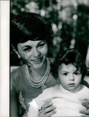 Farah Pahlavi with her son Prince Reza.  Taken - 9 Oct. 1961