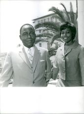 Photo of a man and a woman, smiling.1963