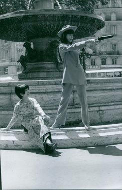 """May Lee Jacques and a woman by the fountain.  """"May Lee Jacques""""  1967"""