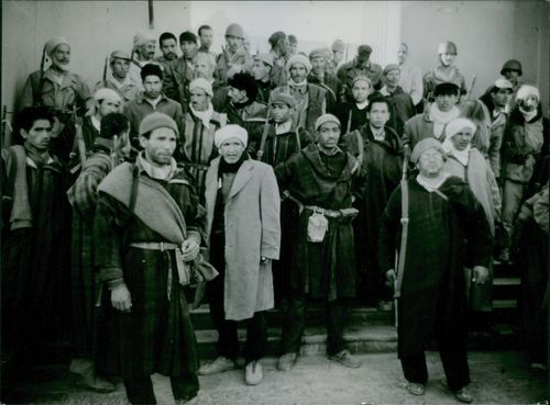 A group of Algerian Freedom Fighter have came back home after Algerian War.