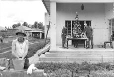 Soldiers decorating the Christmas tree.