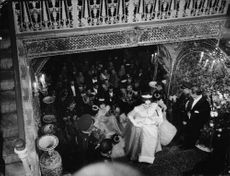 Farah Diba walking up stairs, at her wedding to  Mohammad Reza Pahlavi.