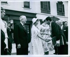 A photo of Princess Alexandra of Kent shakes hands with the guest during a ceremony.