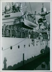 The legionaries of North Africa smile on the cruiser which takes them to reinforce in France.