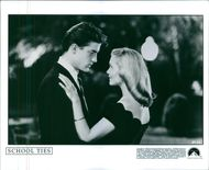 Brendan Fraser and Amy Locane in a scene from a 1992 sports film,