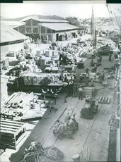 A dock at a U.S. base in the South Pacific is piled with supplies about to be loaded aboard a ship for transportation to Allied fighting fronts in the area.
